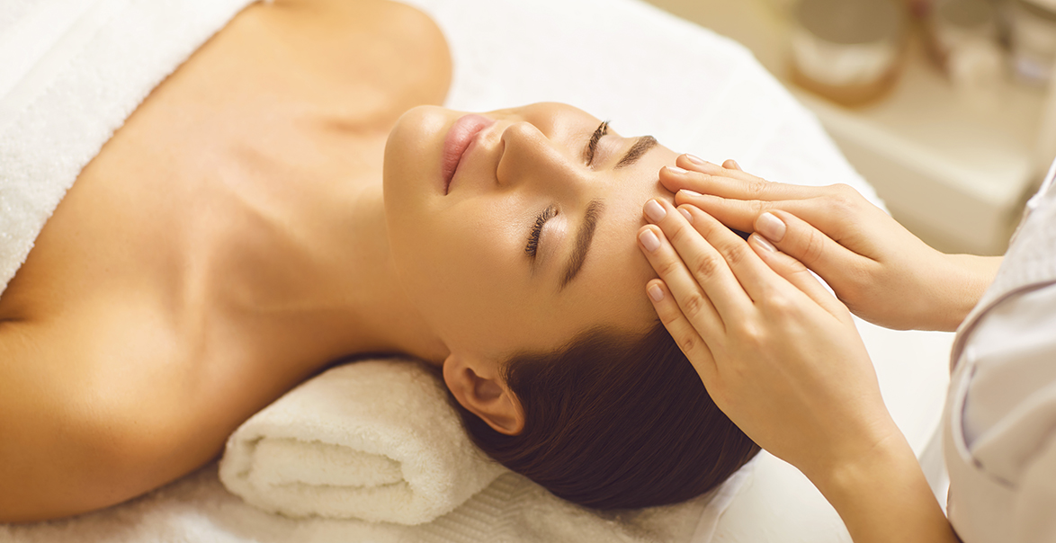 Facial massage to a beautiful girl in a top spa in Utah.